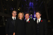 (L-R) Trevor, Janet, Wayne and Ty Gretzky walk the red carpet prior to the 2013 Hockey Hall of Fame induction ceremony on November 11, 2013 in Toronto, Canada.