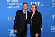 (L) Chief Content Officer Ted Sarandos and (R) Netflix Executive Cindy Holland  attend the Hollywood Foreign Press Association's Grants Banquet at The Beverly Hilton Hotel on August 9, 2018 in Beverly Hills, California.