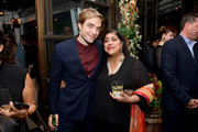 (L-R) Robert Pattinson and Gurinder Chadha attend the Hollywood Foreign Press Association and The Hollywood Reporter Celebration of the 2020 Golden Globe Awards Season and Unveiling of the Golden Globe Ambassadors at Catch on November 14, 2019 in West Hollywood, California.