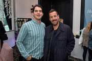 Benny Safdie (L) and Adam Sandler attend The Hollywood Reporter TIFF Studio presented by St. Regis, MAC, and Martell at The St. Regis Toronto on September 09, 2019 in Toronto, Canada.