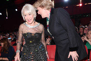 Helen Mirren (L) and Minister of State for Culture and the Media Monika Gruetters (R) at the Homage Helen Mirren Honorary Golden Bear award ceremony during the 70th Berlinale International Film Festival Berlin at Berlinale Palace on February 27, 2020 in Berlin, Germany. Helen Mirren is this years recipient of the Honorary Golden Bear Award of the Berlinale.