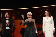 Helen Mirren (C) after receiving the Honorary Golden Bear award next to Artistic Director of Berlinale Carlo Chatrian (L) and Iris Berben at the Homage ceremony during the 70th Berlinale International Film Festival Berlin at Berlinale Palace on February 27, 2020 in Berlin, Germany. Helen Mirren is this years recipient of the Honorary Golden Bear Award of the Berlinale.