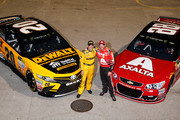 Matt Kenseth, driver of the #20 DeWalt Hurricane Relief Toyota, and Dale Earnhardt Jr., driver of the #88 AXALTA Chevrolet, pose for a photo after qualifying for the Monster Energy NASCAR Cup Series Championship Ford EcoBoost 400 at Homestead-Miami Speedway on November 17, 2017 in Homestead, Florida.