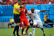 Admir Mehmedi of Switzerland and Wilson Palacios of Honduras collide with referee Nestor Pitana during the 2014 FIFA World Cup Brazil Group E match between Honduras and Switzerland at Arena Amazonia on June 25, 2014 in Manaus, Brazil.