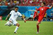 Andy Najar of Honduras  is challenged by Admir Mehmedi of Switzerland during the 2014 FIFA World Cup Brazil Group E match between Honduras and Switzerland at Arena Amazonia on June 25, 2014 in Manaus, Brazil.