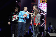 (L-R) Radio personalities Erick, Intern John, Kane and Rose speak onstage at Hot 99.5's Jingle Ball 2016 at Verizon Center on December 12, 2016 in Washington, DC.
