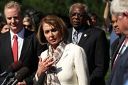 (L-R) U.S. House Minority Leader Rep. Nancy Pelosi (D-CA) (2nd L) speaks as Rep. Chris Van Hollen (D-MD), House Assistant Minority Leader Rep. James Clyburn (D-SC) (2nd R) and Rep. Xavier Becerra (D-CA) (R) listen during a briefing with the media after a meeting with President Barack Obama at the White House June 2, 2011 in Washington, DC. Obama met with the members to discuss the national debt ceiling.