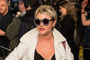 Jamie Winstone attends the House of Holland show during London Fashion Week Fall/Winter 2013/14 at Brewer Street Car Park on February 16, 2013 in London, England.