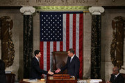 Outgoing U.S. Speaker of the House Rep. John Boehner (R-OH) (C) shakes hands with incoming Speaker of the House Rep. Paul Ryan (R-WI) (L) in the House Chamber of the Capitol October 29, 2015 on Capitol Hill in Washington, DC. Rep. Ryan has been elected to succeed Rep. John Boehner (R-OH) to be the new speaker.