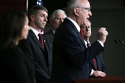 """U.S. House Armed Services Committee Chairman U.S. Rep.  Howard P. """"Buck"""" McKeon (R-CA) (4th L) speaks as (L-R) U.S. Rep.  Martha Roby (R-AL), U.S. Rep.  Rob Whittman (R-VA), U.S. Rep.  Mo Brooks (R-AL), and U.S. Rep.  Joe Wilson (R-SC) listen during a news conference March 1, 2013 on Capitol Hill in Washington, DC. Members of the House Armed Services Committee held a news conference on """"the day that sequestration will take effect, to call for an end to repeated cuts to our national security and focus on the real drivers of our debt and deficits."""""""