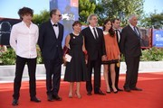 """From left : actor Yann Tregouet, actor Jean-Pierre Darroussin, actress Ariane Ascaride, French director Robert Guediguian, actress Anais Demoustier, actor Robinson Stevenin and actor Jacques Boudet attend the premiere of the movie """"La Villa"""" (The House by the sea) presented in competition at the 74th Venice Film Festival on September 3, 2017 at Venice Lido.  / AFP PHOTO / Filippo MONTEFORTE"""