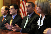 U.S. Speaker of the House Rep. John Boehner (R-OH) (2nd R) speaks to members of the media as he and House Majority Leader Rep. Eric Cantor (R-VA) (2nd L) and Republican negotiators for a conference committee of payroll tax cut negotiation Rep. Dave Camp (R-MI) (L) and Rep. Renee Ellmers (R-NC) listen during a photo-op prior to a meeting December 21, 2011 on Capitol Hill in Washington, DC. The House Republicans called on the Democrats to appoint members to the negotiation table to work on the payroll tax cut extension bill that the House rejected after the Senate approved it.