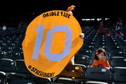 A fan holds up a sign for Adam Jones #10 of the Baltimore Orioles (not pictured) before the start of the Orioles and Houston Astros game at Oriole Park at Camden Yards on September 30, 2018 in Baltimore, Maryland.