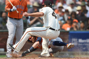 Josh Reddick #22 of the Houston Astros gets tagged out at home plate by Madison Bumgarner #40 of the San Francisco Giants in the top of the sixth inning at AT&T Park on August 7, 2018 in San Francisco, California. Reddick was attempting to score from third base on a wild pitch by Bumgarner.