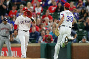 Joey Gallo #13 of the Texas Rangers catches the ball from Doug Fister #38 of the Texas Rangers for the third out in the top of the fifth inning of a baseball game at Globe Life Park in Arlington on March 30, 2018 in Arlington, Texas.