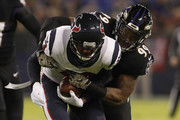 Wide Receiver Braxton Miller #13 of the Houston Texans is tackled by outside linebacker Matt Judon #99 of the Baltimore Ravens in the first quarter at M&T Bank Stadium on November 27, 2017 in Baltimore, Maryland.