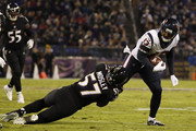 Wide Receiver Braxton Miller #13 of the Houston Texans runs with the ball as he is tackled in the third quarter by inside linebacker C.J. Mosley #57 of the Baltimore Ravens at M&T Bank Stadium on November 27, 2017 in Baltimore, Maryland.