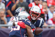 Stephon Gilmore #24 of the New England Patriots intercepts a pass thrown by Deshaun Watson #4 of the Houston Texans (not pictured) in the end zone during the second quarter at Gillette Stadium on September 9, 2018 in Foxborough, Massachusetts.