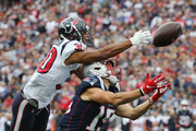 Kevin Johnson #30 of the Houston Texans deflects a pass intended for Chris Hogan #15 of the New England Patriots during the second half at Gillette Stadium on September 9, 2018 in Foxborough, Massachusetts.