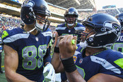 Tight end Jimmy Graham #88 of the Seattle Seahawks celebrates his touchdown with 21 seconds left in the game with Russell Wilson #3 against the Houston Texans at CenturyLink Field on October 29, 2017 in Seattle, Washington.