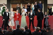 (FromL) British actor Abraham Lewis, Australian actress Nicole Kidman, US director John Cameron Mitchell, US actress Elle Fanning, British actor Alex Sharp, British author Neil Gaiman and British screenwriter Philippa Goslett pose before leaving the Festival Palace on May 21, 2017 following the screening of the film 'How to talk to Girls at Parties' at the 70th edition of the Cannes Film Festival in Cannes, southern France.  / AFP PHOTO / Anne-Christine POUJOULAT