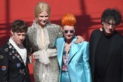 (FromL) British actor Alex Sharp, Australian actress Nicole Kidman, British costume designer Sandy Powell and British author Neil Gaiman pose as they arrive on May 21, 2017 for the screening of the film 'How to talk to Girls at Parties' at the 70th edition of the Cannes Film Festival in Cannes, southern France.  / AFP PHOTO / Antonin THUILLIER