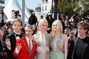 """(L-R) Director John Cameron Mitchell, actresses Nicole Kidman, Elle Fanning and Novel's Author Neil Gaiman attend the """"How To Talk To Girls At Parties"""" screening during the 70th annual Cannes Film Festival at  on May 21, 2017 in Cannes, France."""