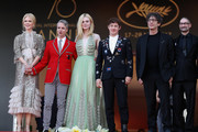 """(L-R)  Nicole Kidman, John Cameron Mitchell, Elle Fanning, Alex Sharp, Neil Gaiman and guest depart after the """"How To Talk To Girls At Parties"""" screening during the 70th annual Cannes Film Festival at Palais des Festivals on May 21, 2017 in Cannes, France."""