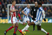 Steve Mounie of Huddersfield Town and Darren Fletcher of Stoke City battles for possesion during the Premier League match between Huddersfield Town and Stoke City at John Smith's Stadium on December 26, 2017 in Huddersfield, England.