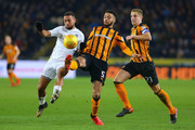 Michael Hector (C) of Hull City wins the ball from Kemar Roofe (L) of Leeds United as Michael Dawson (R) runs in to assist during the Sky Bet Championship match between Hull City and Leeds United at the KCOM Stadium on January 30, 2018 in Hull, England.