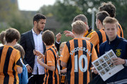 Hatem Ben Arfa of Hull City signs autographs for fans as he arrives for the Barclays Premier League match between Hull City and Manchester City at KC Stadium on September 27, 2014 in Hull, England.
