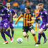 Harry Wilson (C) of Hull City runs past Alexander Tettey (L) and Harrison Reed (R) of Norwich City during the Sky Bet Championship match between Hull City and Norwich City at KCOM Stadium on March 10, 2018 in Hull, England.