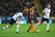 Hatem Ben Arfa of Hull City takes on Harry Kane of Tottenham Hotspur (R) during the Barclays Premier League match between Hull City and Tottenham Hotspur at KC Stadium on November 23, 2014 in Hull, England.