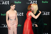 """(L-R) Joey King and AnnaSophia Robb greet  Patricia Arquette as they attend Hulu's """"The Act"""" New York Premiere at The Whitby Hotel on March 14, 2019 in New York City."""