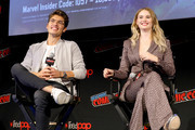 Gregg Sulkin and Virginia Gardner speak on stage at the Marvel's Runaways Screening + Panel At New York Comic Con presented by Hulu on October 04, 2019 in New York City.
