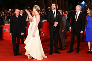 (L-R) Producer Jon Kilik, actors Jennifer Lawrence, Liam Hemsworth, director Francis Lawrence and producer Nina Jacobson attend the 'The Hunger Games: Catching Fire' Premiere during The 8th Rome Film Festival at Auditorium Parco Della Musica on November 14, 2013 in Rome, Italy.