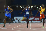 James Dasaolu of Great Britain and Europe (L) wins the Mens 100m ahead of Richard Thompson of USA and Americas and Hua Wilfried Koffi of Ivory Coast and Africas during the IAAF Continental Cup Day 1 at the Stade de Marrakech on September 13, 2014 in Marrakech, Morocco.