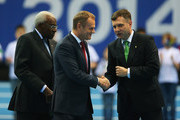 Donald Tusk (C), Prime Minister of Poland shakes hands with Jacek Karnowski (R), Mayor of Sopot as Lamine Diack, IAAF President looks on during the Opening Ceremony on day one of the IAAF World Indoor Championships at Ergo Arena on March 7, 2014 in Sopot, Poland.