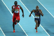 (L-R) Marc Burns of Trinidad and Tobago and Trell Kimmons of the United States compete in the Men's 60 Metres semi final during day two of the 14th IAAF World Indoor Championships at the Atakoy Athletics Arena on March 10, 2012 in Istanbul, Turkey.