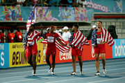 Justin Gatlin, Ryan Bailey, Tyson Gay, and Mike Rodgers of the United States celebrate after winning the final of the menÂ's 4 x 100 metres  on day one of the IAAF World Relays at Thomas Robinson Stadium on May 2, 2015 in Nassau, Bahamas.