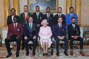 Back row (L-R): Sarfaraz Ahmed (Pakistan), Francois du Plessis (South Africa), Masrafe Bin Mortaza (Bangladesh), Dimuth Karunaratne (Sri Lanka), Kane Williamson (New Zealand), Gulbadin Naib (Afghanistan), front row (L-R) Jason Holder (West Indies), Aaron Finch (Australia), Queen Elizabeth II, Eoin Morgan (England) and Virat Kohli (India) pose for a photograph at Buckingham Palace on May 29, 2019 in London, England. The captains of the teams taking part in the ICC Cricket World Cup meet for a photograph in the 1844 Room at Buckingham Palace in London, ahead of the competition's Opening Party on the Mall.