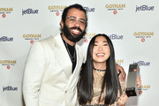 Daveed Diggs and Awkwafina pose with an award backstage during the IFP's 29th Annual Gotham Independent Film Awards at Cipriani Wall Street on December 02, 2019 in New York City.