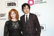 Christina Hendricks and Geoffrey Arend attend IMDb LIVE At The Elton John AIDS Foundation Academy Awards® Viewing Party on February 24, 2019 in Los Angeles, California.