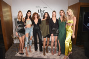 Nadine Leopold, Ping Hue, Ashley Moore, Shanina Shaik, Hannah Ferguson, Caroline Lowe and Devon Windsor pose on stage at The Talks: Meet the Model Squad during New York Fashion Week: The Shows 2018 at Spring Studios on September 10, 2018 in New York City.