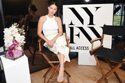 MG model and YouTube personality Emily DiDonato, host of the all-new runway live streaming app, NYFW: All Access, broadcasting live from the Skybox at Spring Studios during NYFW: The Shows on September 11, 2019 in New York City.