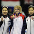 Elise Christie Photos - (L-R) Min-Jung Kim of Korea, Elise Christie of Great Britain and Soyoun Lee of Korea display their medals in medal ceremony of Ladies 1000m FinalA during day two of the ISU World Cup Short Track at Nihon Gaishi Arena on December 1, 2012 in Nagoya, Japan. - ISU World Cup Short Track Nagoya - Day 2