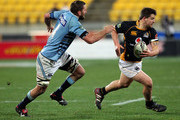 Dane Coles of Wellington runs the ball under pressure from Bryce Williams of Northland during the round 8 ITM Cup match between Wellington and Northland at Westpac Stadium on August 10, 2011 in Wellington, New Zealand.
