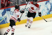 Gina Kingsbury (R) of Canada and teammate Jennifer Botterill celebrate Kingsbury's goal in the third period against Slovakia  during their women's ice hockey preliminary game at Canada Hockey Place on February 13, 2010 in Vancouver, Canada.  Canada won the game 18-0.