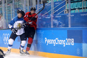 Veli-Matti Savinainen #86 of Finland collides with Marc-Andre Gragnani #18 of Canada in the first period during the Men's Play-offs Quarterfinals on day twelve of the PyeongChang 2018 Winter Olympic Games at Gangneung Hockey Centre on February 21, 2018 in Gangneung, South Korea.