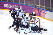 Kimmo Timonen #44 of Finland loses his helmet against Zach Parise #9, Jonathan Quick #32 and Ryan McDonagh #27 of the United States in the first period during the Men's Ice Hockey Bronze Medal Game on Day 15 of the 2014 Sochi Winter Olympics at Bolshoy Ice Dome on February 22, 2014 in Sochi, Russia.